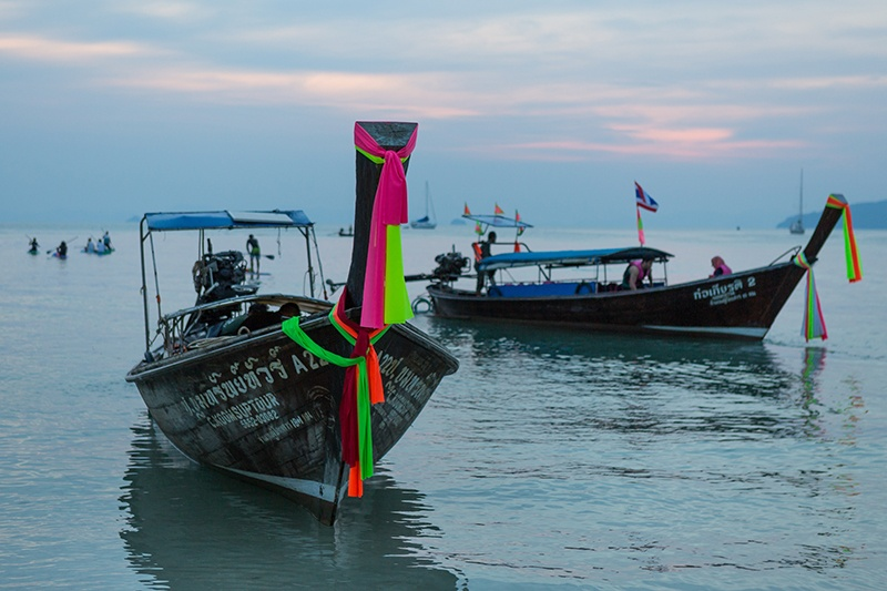 Longtail boats moored at Railay Beach Thailand
